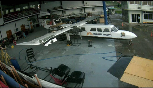 The Britten Norman Trislander aircraft on which the explosion occurred in the Roraima Airways hangar. The damaged wing is visible at left.