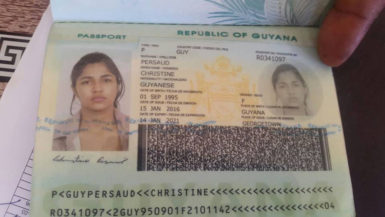 The information page in the fake passport that was being used by Anjanie Boodnarine, who went by the name Christine Persaud. (Royston Drakes photo)
