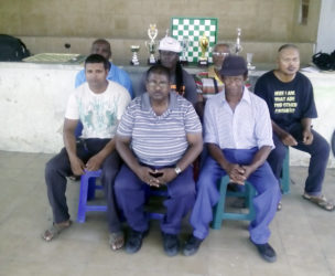 In picture front row from right, Ulric Brathwaite, Jiaram and Khemraj Pooranmall. Back row from right, NavinMegbarran,Rudolph Gentle, Lyndon Heywood and Floyd Cumberbatch.