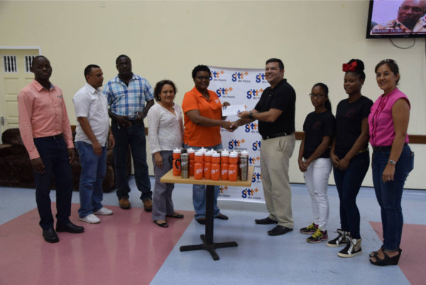 GHB President Philip Fernandes (centre) collects the sponsorship cheque from GTT Public Relations Officer, Allison Parker while members of the both organizations look on following the launch of the long-standing tournament.