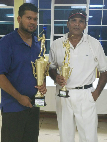 Father and Son! First and fourth place winners, Richard and Fazil Haniff pose with their trophies