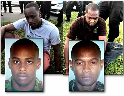 Ex-Special Forces officers Devon Edwards, left, and Steve Douglas, who were held by the Highway Patrol with illegal guns in Charlieville, Chaguanas, yesterday.