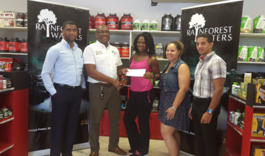 Banks DIH's Clive Pellew (second left) presents his company's sponsorship package to Noshavyah King, in the presence of (from left) Errol Nelson, Jordana Ramsey-Gonsalves and Jamie McDonald.