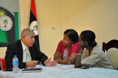 Public Health Minister Dr. George Norton speaking with some members of the public. (PNCR photo)
