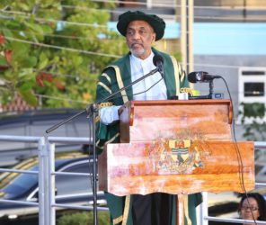 Dr. Vincent Adams, Deputy Field Manager at the United States' Department of Energy, delivers the commencement speech to the graduates at the University of Guyana's 50th Convocation Ceremony. Adams urged the graduates to stay in Guyana and use all possible opportunities to make the country great. (Photo by Keno George)