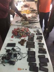 Knives, improvised weapons and cellular phones were among the items Joint Services ranks found during operation Safeguard at the Georgetown Prison yesterday morning. (Ministry of the Presidency photo)