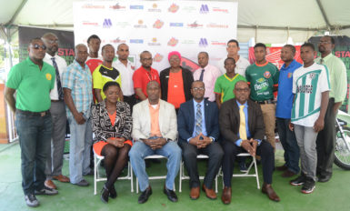 United Force-Members of the GFF Stag Beer Elite League launch party-Sitting from left to right- 3rd Vice-President Thandi McAllister, 1st Vice President Brigadier General Bruce Lovell (rtd.), GFF President Wayne Forde and 2nd Vice President Rawlston Adams- Standing are representatives of the sponsors and competing teams.