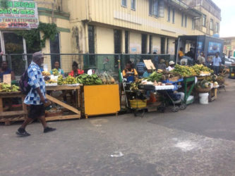 Fruit vendors now plying their trade outside of the former Guyana National Cooperative Bank building at Lombard and Hadfield streets.