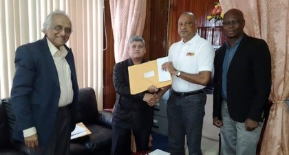 Present at the handing over  were:  Jaipaul Sharma (second from left) -Minister within the Ministry of Finance, Seelall Persaud-Commissioner of Police (second from right),  Sydney James (right) - Assistant Commissioner of Police and Head of the Special Organized Crime Unit (SOCU) and Christopher Ram-Forensic Auditor (left).