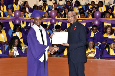 Valedictorian of the Class of 2016 of the President's College,  Camroul Hookumchand receives the President's Award from President David Granger. (Ministry of the Presidency photo)