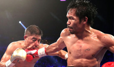 Manny Pacquiao catches Jesse Vargas flush with a right hand. (Photo courtesy of Fightnews website)