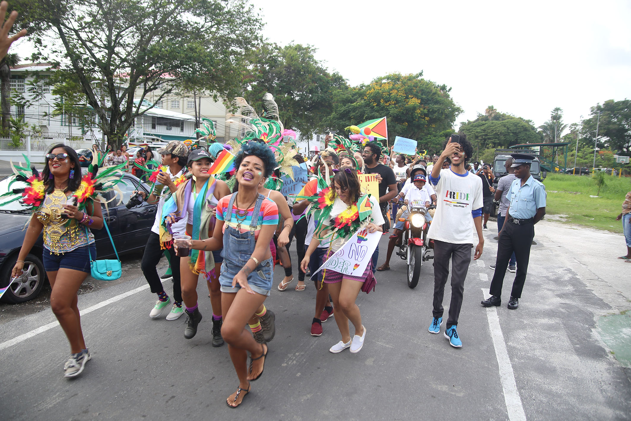 Activist Akola Thompson Leads The Hundreds That Made Up Procession For Guyana S First Pride Parade As It Moved Off From Ground In Georgetown