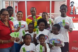 Youths from the Kingston and Tiger Bay communities receive their CONCACAF Nations League Guyana vs. Belize tickets at Digicel's Head office in Kingston. In the photo is Digicel Communications Director Vidya Sanichara