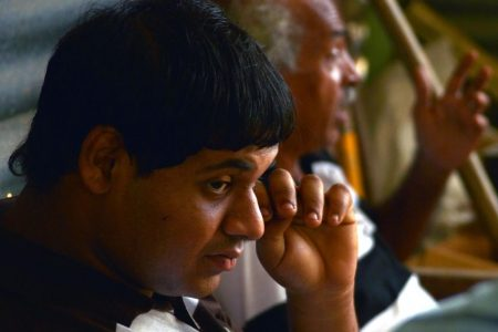 17-year-old Govinda Mathura, during a prayer service at his family's home at Hilltop Drive, Morne Roche, Gasparillo.