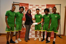 KFC's Training Manager Charissa Rampersaud [center] handing over the company's sponsorship cheque to Golden Jaguars captain Sam Cook in the presence of team-mates [from to left]-Neil Danns, Walter Moore, Trayon Bobb and Gregory Richardson