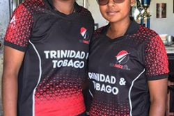Player of the match Leandra Ramdeen and Karishma Ramharack embrace each other after wrecking Leeward yesterday at Bourda