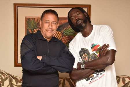 Police Commissioner Gary Griffith strikes a pose with Jamaican reggae artiste Buju Banton after meeting him at the Hilton Trinidad Saturday night. Griffith met with Banton to assure him that the rest of his stay in T&T would be comfortable after officer raided Banton's hotel room hours before.