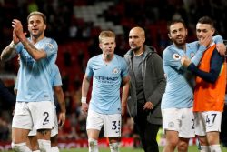 Manchester City manager Pep Guardiola (centre) and Oleksandr Zinchenko after the match with Manchester United on Wednesday. Action Images via Reuters/Carl Recine