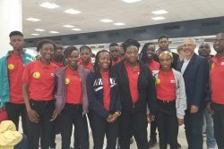 Team Guyana pose for a photoyesterdayat the Miami International Airport with former Member of Parliament, Dominic Gaskin.