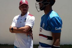 Ramnaresh Sarwan (left) chats with Shai Hope during the training camp at 3W's Oval, UWI Cave Hill Campus. (Photo courtesy CWI Media)